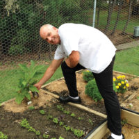 Chef Neil Carpenter in the vegetable garden.